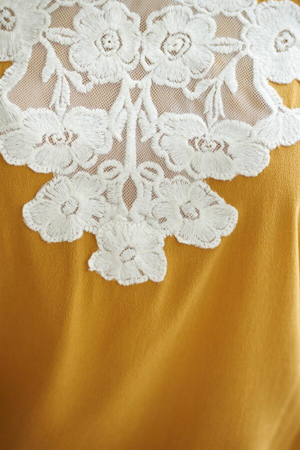 Flared embroidered yellow office women`s blouse